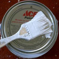 Paint can spruce up a fireplace.