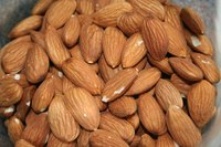 Almonds have good cholesterol, which can help remove plaque from arteries.