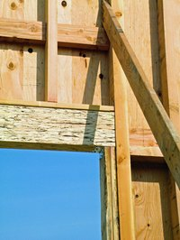 Headers support the space over windows and doors in standard house framing.