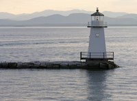 You can view the lighthouse on Lake Champlain from a houseboat.