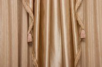 Elegantly pleated draw drapes are easy to make.
