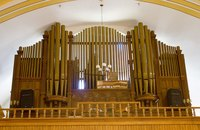 An organ is a complicated instrument with a majestic sound well-suited to hymns and praise music.