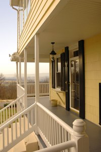 Porch space provides a way to relax and take in outdoor views.