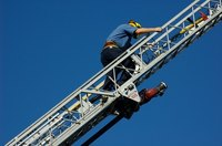 Firefighter training includes learning how to use equipment such as ladders.