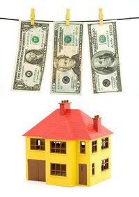 Buy home by paying back taxes.