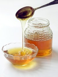 Make a honey lemon remedy for a sore throat.