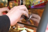 Slot machines charge a small amount for a slim chance of winning a large reward.