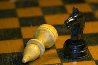 Make sure to measure carefully when constructing your chess and checkerboard.