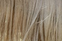 Keratin glue is used to attach hair extensions.