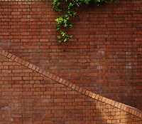 Some brick stairways require protective metal railings.