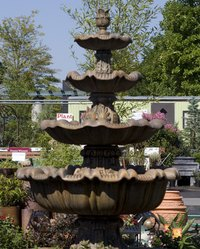 Remove algae from an outdoor fountain with bleach.