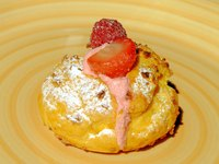 Cream puffs are filled with pastry cream and can be topped with anything you prefer