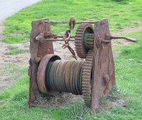 An old stationary winch where the body of the machine serves as the nonmovable object.