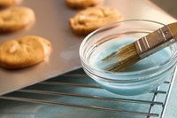 Clean nonstick cookie sheets with non-abrasive materials.