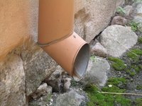 Downspout drains often require drainage pipes to move water away from the building.