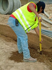 Under the classification approach, a construction worker might be grouped with other laborers.