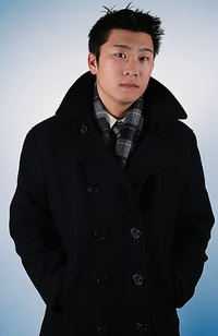 Man in classic black overcoat with upturned collar