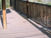 Strip paint off your wood porch to restain it.