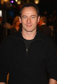 "Jason Isaacs wears a zip up sweater to the ""Valkyrie"" premiere in London in 2009."