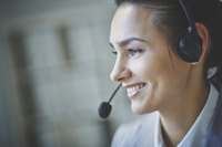 Smiling telemarketer on headset
