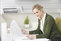 A businesswoman is sitting at a desk.