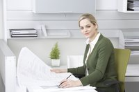 A businesswoman is working at her desk.