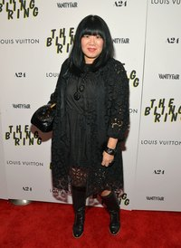 Fashion designer Anna Sui demonstrates how to wear black boots on a fuller body.