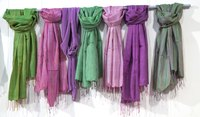 Add a splash of color to your wardrobe with a pastel-hued pashmina scarf.