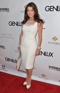 Reality television star Lisa Vanderpump wears a white dress to a red carpet event.