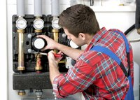 A technician services a heating system.