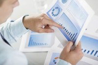 Close-up of businessman looking at business chart with sales data