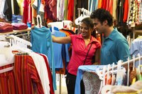 A woman and man are shopping together.