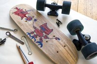 Disassembled skateboard with illustration on bottom