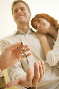 At closing, the title agent completes a real estate transaction.