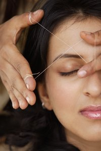 Threading is effective at removing facial hair.