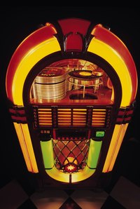 Cardboard can be painted to resemble the wood, metal and light-up features of a jukebox.