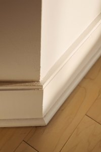 Baseboard and shoe molding must come off before you lay a new floor.