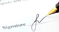 Close-up of signature being signed on document.