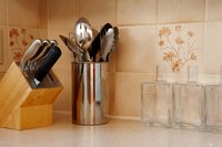 Create room for a ceramic backsplash by removing the preformed backsplash on your countertop.