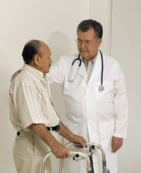 A doctor talks to a elderly male patient