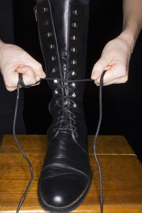 Tying vintage boots is part comfort and part fashion statement.