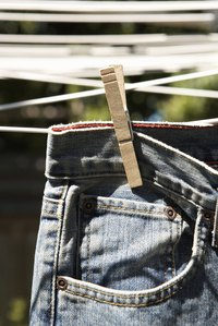 Hanging jeans to dry helps prevent shrinking.