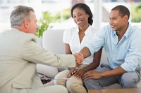 Salesman shaking hands with potential clients