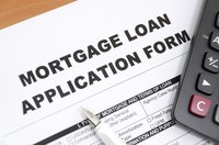 Mortgage loan form with pen and calculator.