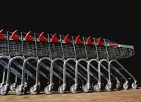 A row of empty shopping carts.