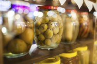 Pickled foods in jars on a shelf.