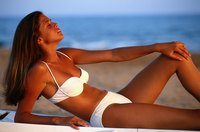 Spray tans adhere to the top layers of skin.