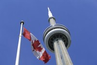 CN Tower next to Canadian flag