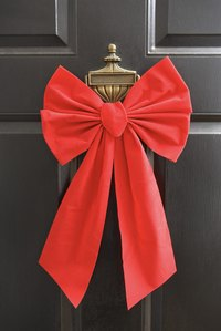 A big bow makes your door festive and welcoming.