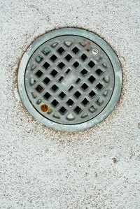 Drains in concrete slab floors are common in basements.